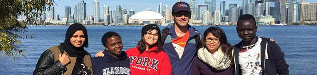 Students standing in group with Toronto skyline in the background